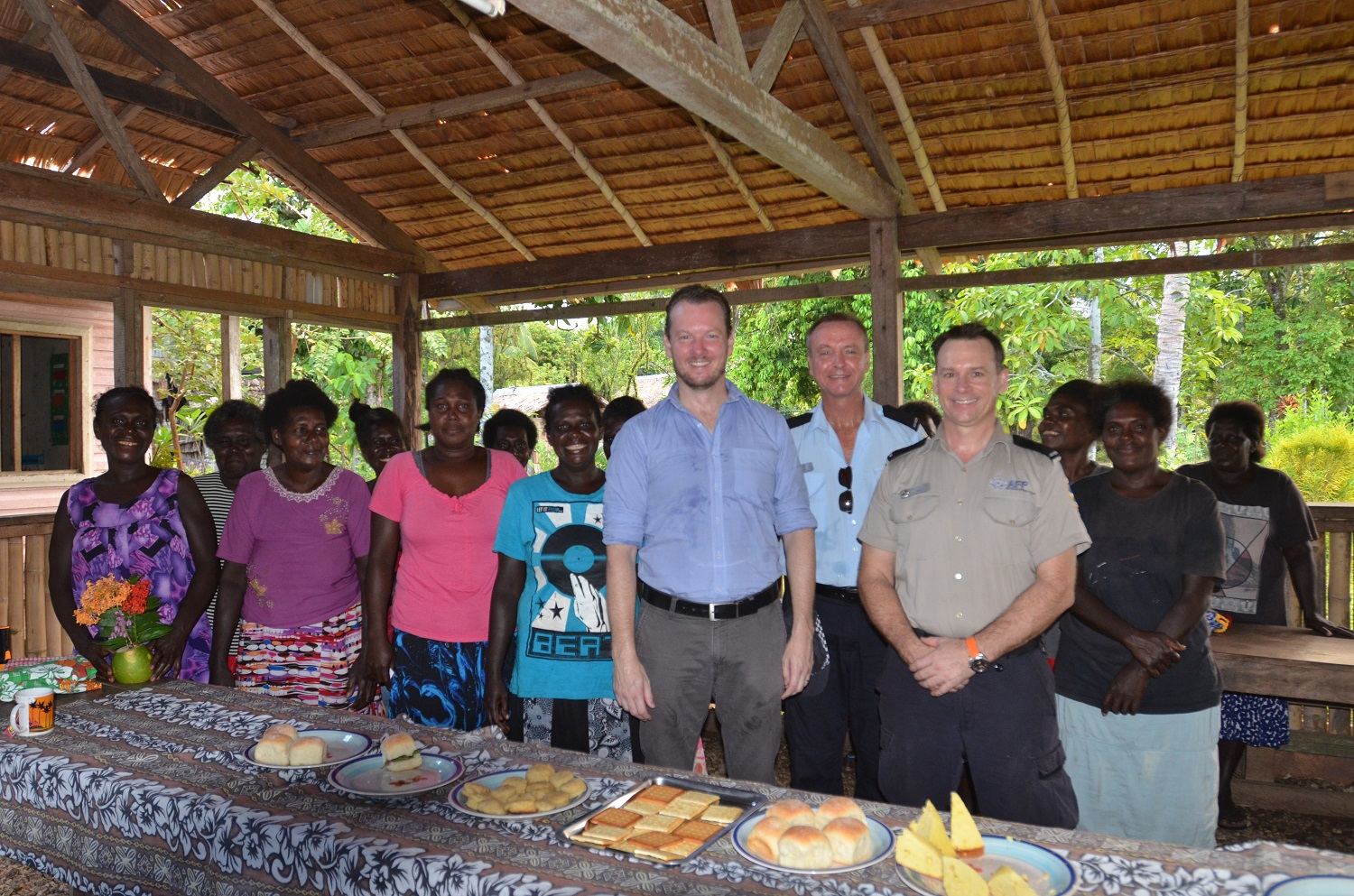 Women of Mono, in the Shortland Islands farewell the RAMSI team with a hearty village breakfast