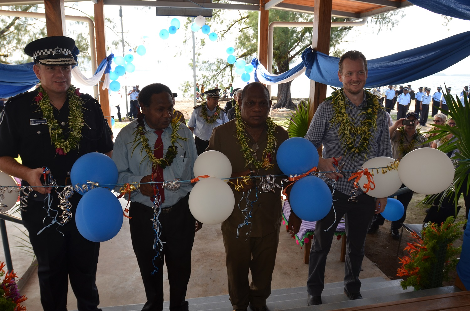The cutting of the ribbon to officially open the new Tulaghi Police Station